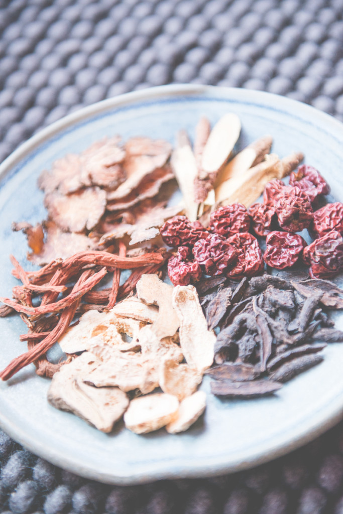 A colorful plate of dried herbs and plants.